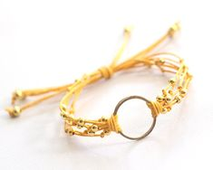 Dana Karma Bracelet made of Sunshine Yellow Waxed Cotton Cord with Gold Ring and Beads Accents
