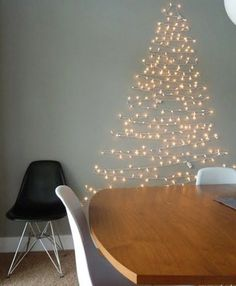 String Christmas lights on a wall in the shape of a Christmas tree! Creative Christmas Trees for Small Spaces Wall Christmas Tree, Creative Christmas Trees, Noel Christmas, Holiday Tree, Xmas Trees, Christmas Stockings, Christmas Crafts, Fake Trees, Green Christmas