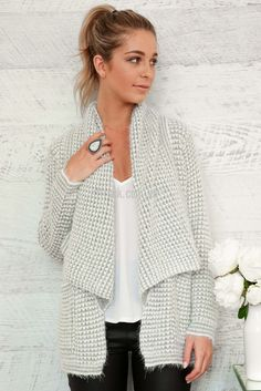 Oxford Super Soft Knit in Grey and White $69.90  Super soft and snuggly, the Oxford Waterfall Cardi in grey and white is the perfect winter warmer.  With a contrasting cream and black knit the fall of the wide collar and oversized pockets are perfect for exploring the winter wonderland.   Model wears a size S/8 and is 172cm tall. 70% Acrylic, 30% wool.