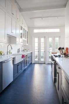 Love french doors with windows above Cupboards to the ceiling Textured subway tile Marmoleum Floor