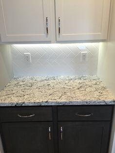 kitchen backsplash in a white 3x6 subway tile in a vertical herringbone install - Vertical Tile Backsplash