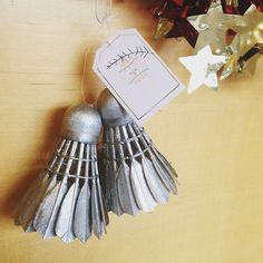 DIY silver bells! Badminton Birdies spray painted silver to make wonderful Christmas Tree ornaments. There's a bell hanging in the inside :)
