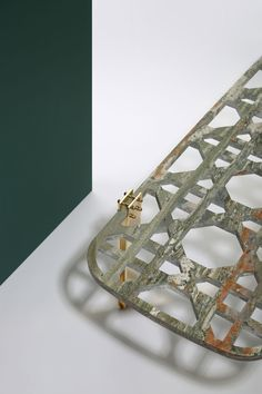 EVERLASTINGREENcoffee table in granitvert Gauguin , solid brass and metal, part of the Khayzaran/Fairuz collection by Lebanese interior architect and product designer Richard Yasmine. Photo by Bizarrebeirut.