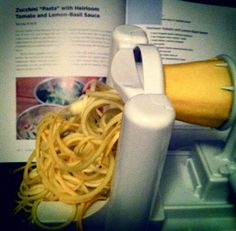 "vegetable spiral maker. made raw tomato and basil ""pasta"" with summer squash and zucchini noodles."