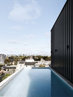 Open House | Alexandra Penthouse by Dita Studio Indoor Outdoor Living, Outdoor Fire, Black Cladding, Blue Mosaic Tile, Suburban House, Curved Staircase, Australian Architecture, Pent House, Luxury Apartments