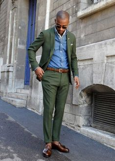 Nail that dapper look with a dark green blazer and dark green dress pants. Want to go easy on the shoe front? Grab a pair of dark brown leather tassel loafers for the day. Shop this look for $312: http://lookastic.com/men/looks/sunglasses-scarf-pocket-square-denim-shirt-blazer-belt-dress-pants-tassel-loafers/4529 — Dark Brown Sunglasses — White Silk Scarf — White Pocket Square — Blue Denim Shirt — Dark Green Blazer — Brown Leather Belt — Dark Green Dress Pants — Dark Brown Leather ...