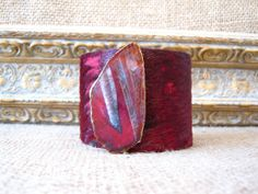 cranberry red hair on hide over brass cuff by FineAndFunkyJewelry, $50.00