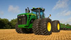 It is one of the largest production tractors in the world, and the largest made by John Deere upon its release in 2007. Description from abstract.desktopnexus.com. I searched for this on bing.com/images