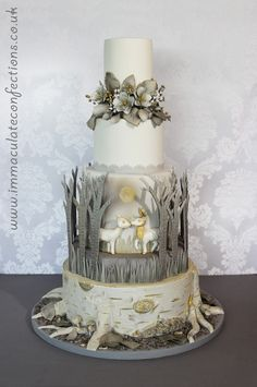 This cake, which has a wintry-woodland-Narnia theme, won my second Gold at Cake International, London. It features everything from a tree-stump base to free standing birch trees… wild roses, gold berries and deer kissing in the moonlight. I am, of course, exceedingly proud of this cake cake and original design Winter Woodland Wedding Cake - Cakes by Natalie Porter - Hertfordshire and Essex