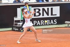 Martina Hingis of Switzerland returns the ball Ekterina Makarova and Elena Vesnina of Russia during the Women's Doubles Final during the WTA Tennis Open tournament final at the Foro Italico on May 15, 2016 in Rome.
