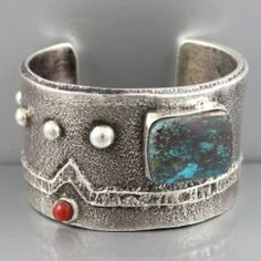 Cuff | Stewart Billie. (Navajo).  Sterling silver, Chrysocolla and Red Coral