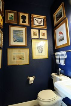 navy walls & gold frames in powder bath  from Suburban Bitches