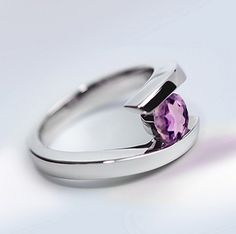 Pretty amethyst with flashes of rose in a classic bypass design. Made by Joryel Vera, so it feels smooth on the finger and looks great on. Amethyst have been