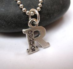 Hand stamped initial charm necklace. $40.00, via Etsy.  Would dig an H, with CTRJ stamped on it.
