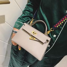 And ABL means Astro Boy Lady, because she used to have an Astro Boy bag charm that she always attached to her bag of the day. Hermes Kelly Bag, Hermes Bags, Hermes Handbags, Purses And Handbags, Elegant Style Women, Fashion Bags, Fashion Accessories, Luxury Bags, Beautiful Bags