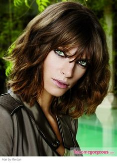 Wavy layered bob with long bangs.  Nice dark caramel brown color too.