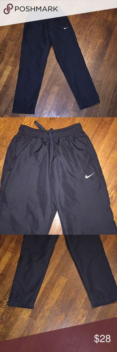 Navy blue sweat pants Navy blue Nike sweat pants  Body- 100% polyester  Upper lining- 100% polyester  Lower lining- 100% nylon 40 1/2 inches down Nike Pants