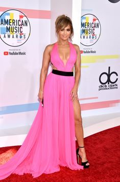 Jennifer Lopez Goes Very Jennifer Lopez in Hot Pink Cutout Dress at the 2018 American Music Awards Jennifer Lopez, American Music Awards, Pink Gowns, Pink Dress, Taylor Swift, Elie Saab Couture, Nice Dresses, Formal Dresses, Evening Dresses