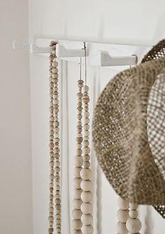 long strings of chunky wooden beads. FleaingFrance.com