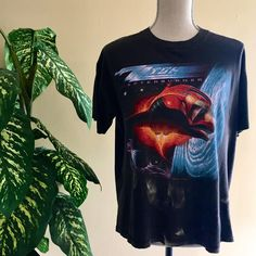 A personal favorite from my Etsy shop https://www.etsy.com/listing/524833108/1986-zz-top-afterburner-graphic-tee-t