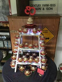 Cupcake stand. Old ladder. Used mason jar lids.
