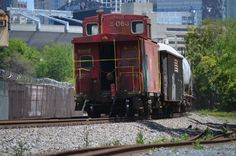 NS local P43 lead by 3016, and followed by an old N&W caboose at Summit Avenue in Charlotte, NC, on April 15, 2016