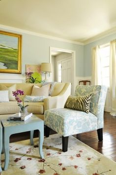 """""""I like this room - fresh, the juxtaposition of the fabrics, light and bright. Not too fond of the rug, but I love the colors together and the zebra print with the flowers."""""""