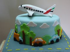 - Airplane made of gumpaste, cars and trees, clouds al fondant...... chocolate cake with chocolate ganache filling
