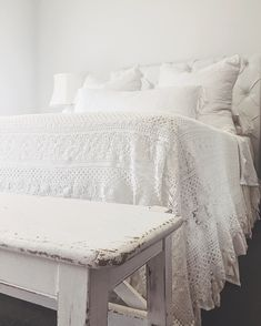 The wooden bench at the foot of the bed. ~zb