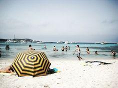 Black and yellow umbrella on the beach :)