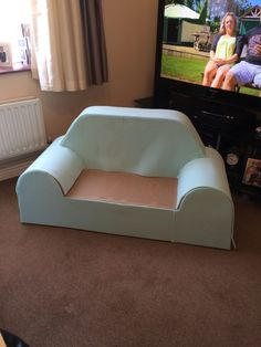 Cardboard childrens sofa with foam attached awaiting cover