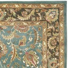An intricate Oriental design and dense, thick pile highlight this handmade rug. This floor rug has a blue background and a brown border and displays stunning panel colors of ivory, green, red, rose and blue.
