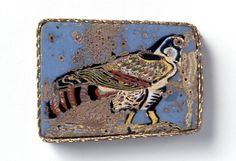 Mosaic glass, 1st century B.C.E.  A rectangular decorative plaque with pale blue ground and falcon standing and facing to the right. The body feathers are shown in white and black, while the details are depicted in black, yellow, red, cobalt, purple and green. The falcon was the most sacred bird in Egypt and the god Horus, the deity protecting royal authority, was symbolized by this bird.  Text and image from the website of the Miho Museum.