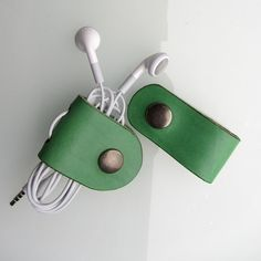 Earbud / earphone / cable organizers in green vegetable tanned leather, handmade by RinartsAtelier