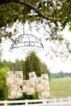I love the mason jars! These are hanging from a cute iron design. I'm sure you could find something similar in Home Depot or the like.