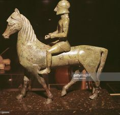 Grumentum Horseman, Greek bronze, 550 B.C. This bronze horse and rider is one of the earliest pieces of sculpture to survive from what is known as Western Greece (Magna Graecia). Though it is small, the horse and rider have a monumental quality which seems to give them dignity and status. The warrior wears a Corinthian-style helmet and a short tunic. He once held a spear and reins, that were probably made of copper wire. Both horse and rider are extremely fine examples of bronze-casting.