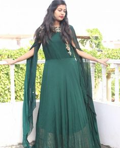 Embellished bottle green Flared Anarkali Gown with cape sleeevs ; Color/ Fabric Details- Light Blue Georgette Anarkali Gown with Golden handwork on the yoke section.