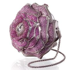 Judith Leiber's Precious Rose handbag. 1016 diamonds, 1169 pink sapphires and 800 pink tourmalines. 18k white gold. Only one was ever made and it's no longer available from Leiber's boutique. $92.000