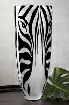 Zebra Vase from Midnight Velvet. An incredibly eye-catching accent, this glass vase has a zebra face with raised black stripes on a frosted glass background. (And it may be the first vase whose nose you want to pet! Arte Zebra, Animal Print Decor, Animal Prints, Zebra Face, Zebra Decor, Decoration Originale, Frosted Glass, Zebra Print, Home Decor Accessories