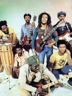 bob marley and the wailers.  Loving his faded jeans and sweater vest over long sleeve fitted tee!