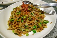 """Still thinking about this amazing Teochew fried Kway Teow with diced Kai lan at Chui Huay Lim Teochew Cuisine restaurant in Singapore. The """"wok hay"""" (food which captures the breath of a well seasoned and heated wok) was just lifting off the dish even before it landed on the lazy susan. A simple fried rice noodle dish, but so well executed it puts many others to shame. #FMFinSingapore #Singapore #Teochew #ChiuChow #ChineseFood #latergram #comfortfood #noodles Kai Lan, Noodle Dish, Well Seasoned, Lazy Susan, Rice Noodles, Comfortfood, The Dish, Wok, Chinese Food"""