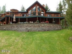 MLS# 312849 Wonderful open floor plan on 10 acres. master bed/bath & den are on the main level. lots of deck and patio area from which to enjoy the peaceful setting. less than 5 mi. from whitefish in desirable whitefish stage road area. attached triple garage and 4th bedroom/bath were added in 2009. 14x48 storage shed/barn is wired. home is an excellent value lots of charm. Equal Housing Opportunity. Information deemed reliable but not guaranteed by National Parks Realty. Listed by: Jeff…