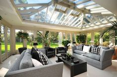 London home - solarium. But with Grey an yellow furniture. Love the Indoor plants. Pretty much defines awesome.
