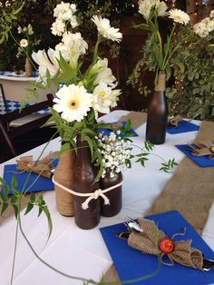 Centerpieces with painted beer glasses and twine. Great for harvest parties or Oktoberfest decorations.