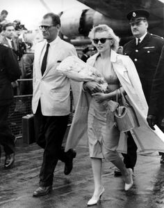 Marilyn Monroe and Arthur Miller arriving in England to film The Prince and the Showgirl, 1956