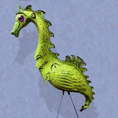 Seahorse Flamingo - handmade, garden art sculpture created from a recycled pink plastic flamingo.. $70.00, via Etsy.