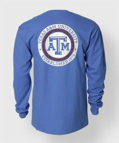 "This longsleeve cobalt shirt features a white block ATM on the front. The back has a block ATM in a white circle surrounded by a maroon trellis pattern with a white outlines that reads ""Texas A&M University. Established 1876""."