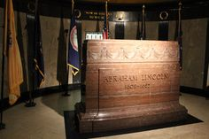 The final resting place of Lincoln is 10 feet below this slab of marble. Grave robbers had attempted to take his remains in 1876. So when the whole burial site was renovated around 1900, son Robert insisted on making the remains untouchable. Lincoln was put in a metal cage, which was then encased in concrete and sunk well below the surface. Mary is in the wall behind him, as are sons Eddie, Tad and William. Only Robert is missing from the tomb; he's in Arlington National Cemetery.