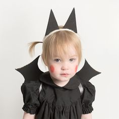 You can make this simple child's bat costume with just a bit of cardboard for the wings and the ears!
