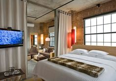 Brick walls and ultra modern amenities love the total Loft feel of this interior NYLO Warwick - could easily be done in an Urban Loft